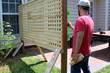 use scrap wood to prop up screen