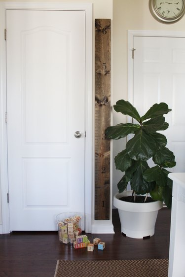 DIY wooden wall measuring stick growth chart