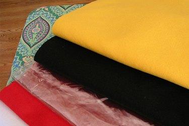 Golden, black, red, white felt and clear vinyl