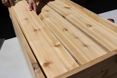 """lay out three 34 1/4"""" wood planks   how to make an elevated planter box"""