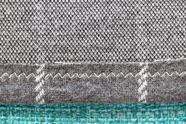 Back view of a hem sewn with a zig zag stitch.