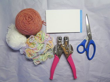 What you need to make a pompom bookmark.