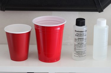 Mixing hardener and resin in plastic cups