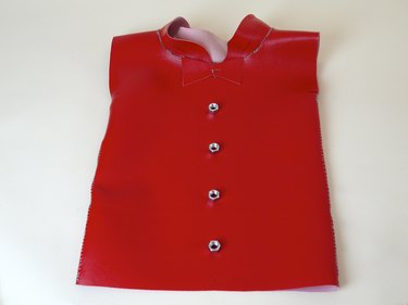 gluing hex nuts on the shirt