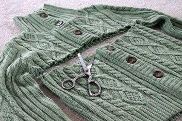 Cardigan sweater cut, just below sleeves