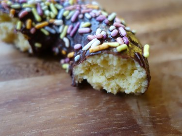 Healthy coconut flour low carb chocolate covered donut with sprinkles.