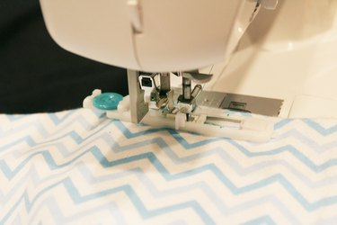 Sewing the button holes.