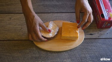 Preparing cheese for freezing.