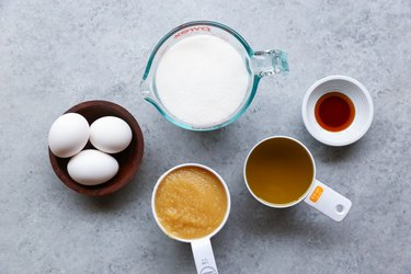 Measuring cups of wet ingredients for carrot cake
