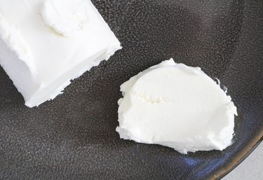 Slice a piece of goat cheese