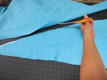 Cut two fins out of fleece fabric