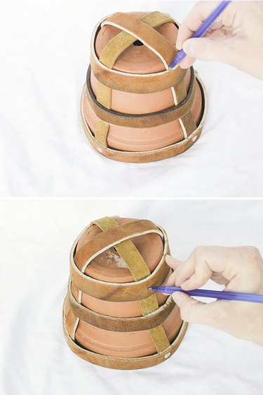 Marking leather support straps.