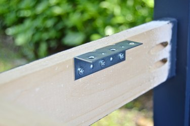 screw corner braces onto bench to support seat