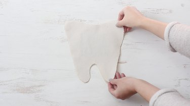 Placing right sides of pillow pieces together