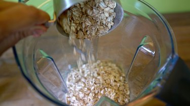 Pouring oats into blender.