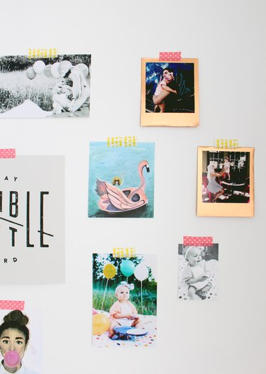 Photos on a wall with decorate tape.