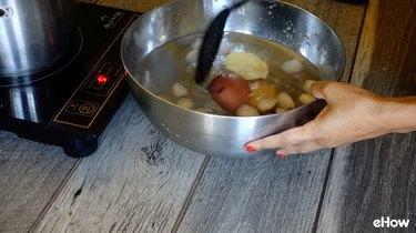 Blanching potatoes for freezing.