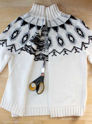 Pullover sweater cut up the center