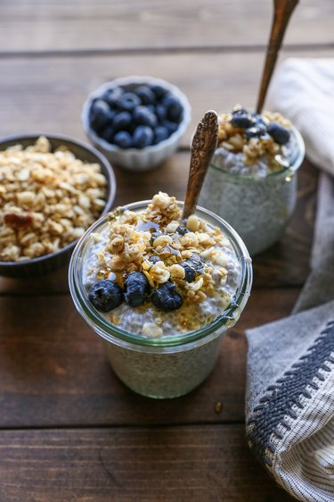 jar of chia seed pudding with blueberries, honey, and granola