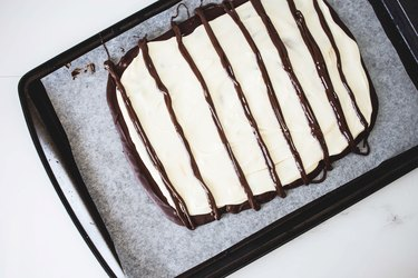 Piped vertical chocolate lines.