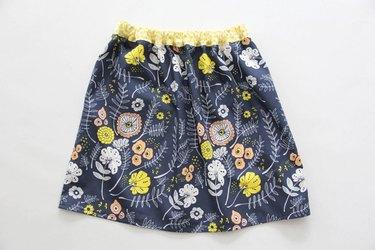 Sew an easy elastic waistband onto your gathered skirt