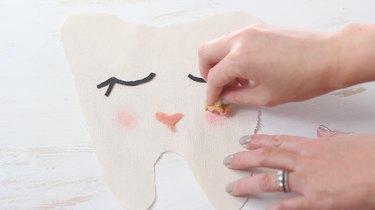 Painting cheeks on fabric