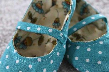 Finished aqua cloth baby shoes