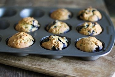 Tray of fresh-baked blueberry muffins.