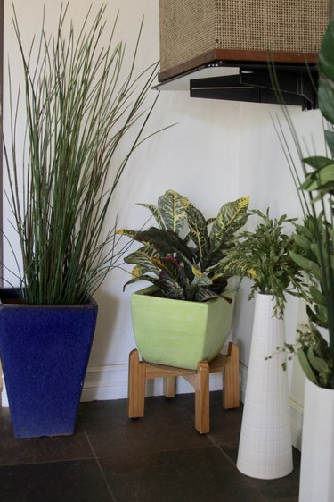 Living room with faux plants.