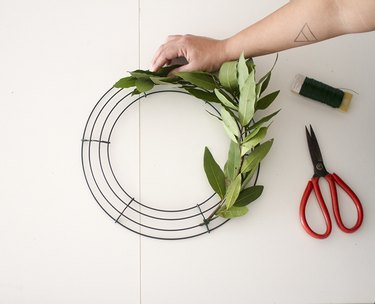 Wrapping olives greens to make a wreath