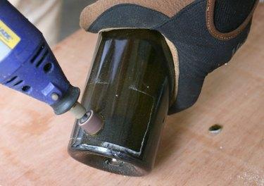 Sanding a glass bottle