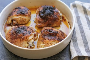 Four chicken thighs in a casserole dish