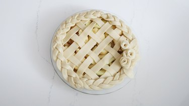 Pie decorated with lattice, braids and roses