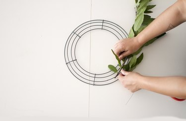 Tie olive greens to wreath