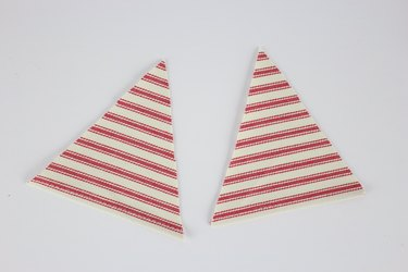 Cut out two triangles.