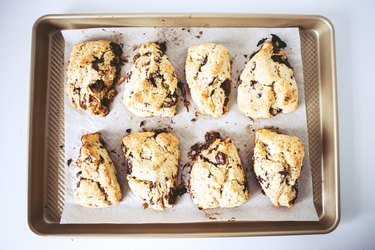Baked scones on a baking tray.