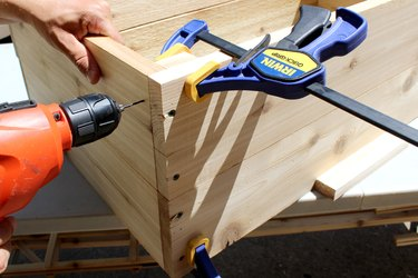 """drill pilot hole and deck screws to attach 9"""" wood slat 