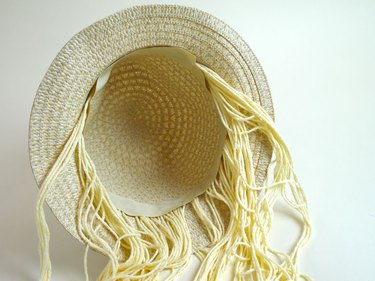 Yarn glued to the inside of the hat.