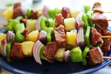 Shish kabob skewers loaded with meat and vegetables.