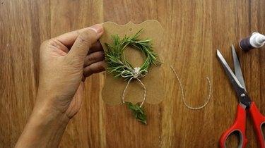 DIY rosemary Christmas wreath gift tag.