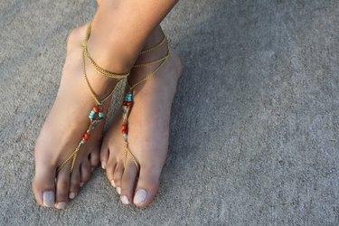 pink sandals on female feet