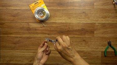 Preparing wire for DIY glass beaded garden sparkler.
