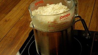 Melt wax in double boiler.