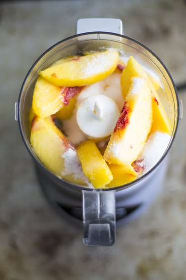 Place peaches into food processor.