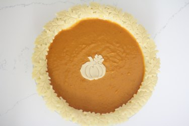 Pie decorated with pumpkin and leaves cutouts