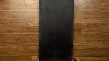 DIY chalkboard serving tray, primed and painted prior to removing masking tape.