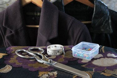 Materials needed to refashion a coat.