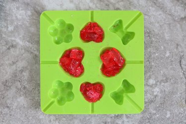 Fill the heart mold with candy
