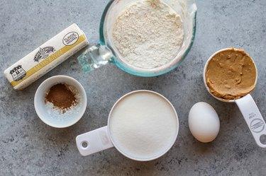 measuring cups of ingredients for cookies