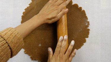 Rolling out dough for gluten-free, low-carb gingerbread cookies
